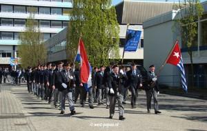 Foto van vetrenaren met vlaggen van Nederland en West Papua
