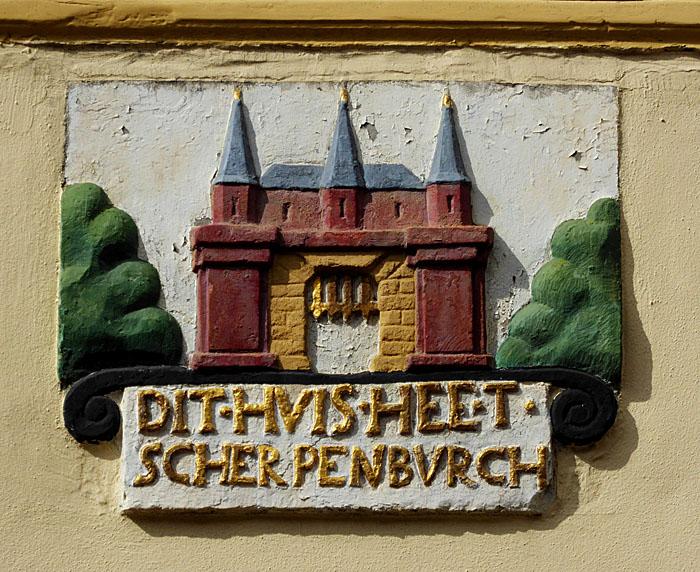Foto van gevelsteen met kasteel