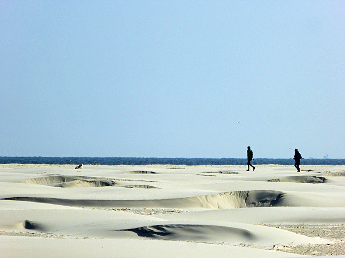 Foto van breed strand