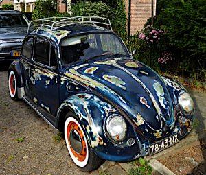 Foto van Volkswagen Kever met schuurvlekken